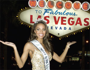 Miss USA 2008 poses in front of the Welcome to Las Veags sign.