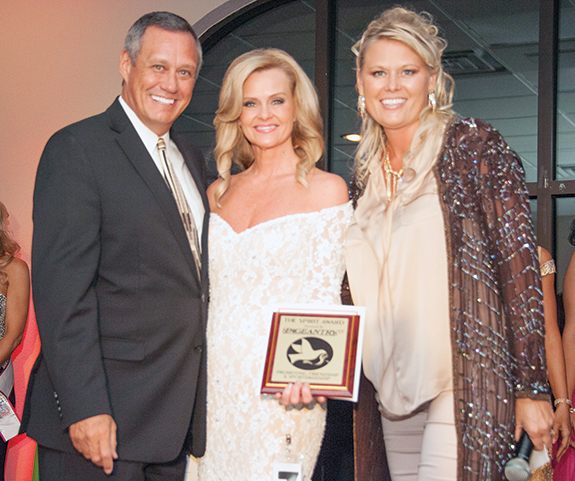 Pageantry CEO Carl Dunn and WM&T President Snejanna Dunn present the Pageantry Spirit Award to Teresa Hyatt