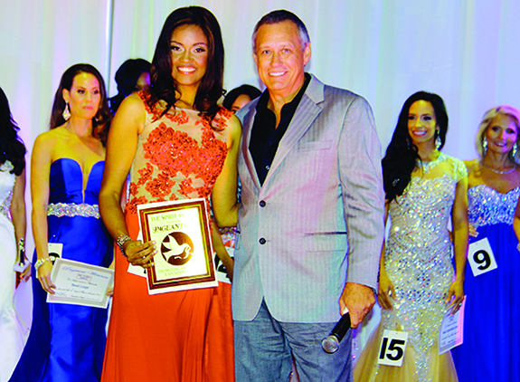 Pageantry CEO Carl Dunn presents the Pageantry Spirit Award to Kimberly Gibson