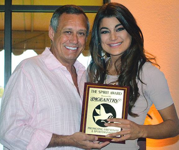 Pageantry CEO Carl Dunn presents the Pageantry Spirit Award to showcase model Victoria Sarone for her neverending enthusiasm.